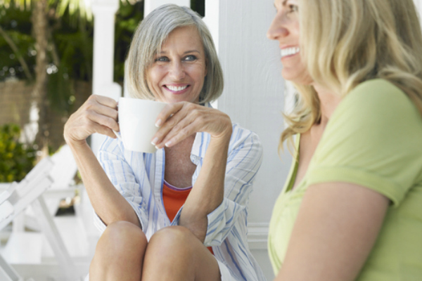Caregiver speaking with a friend over coffee