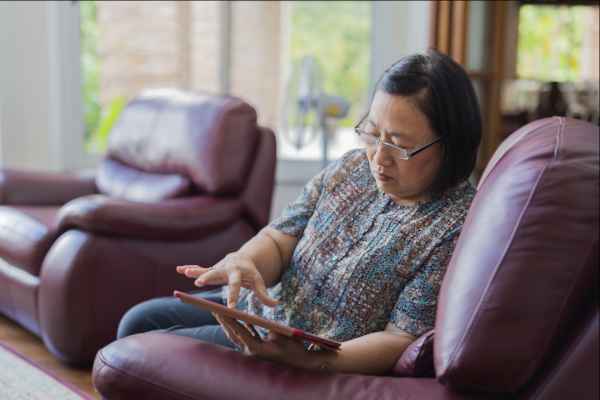 Image of a woman researching care options