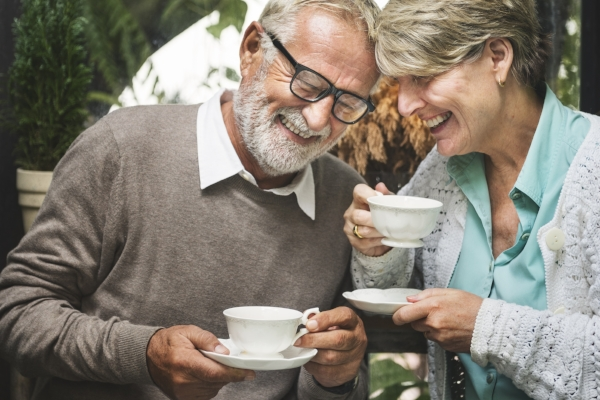 Man and wife laughing over tea