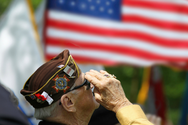 Veteran saluting the American flag