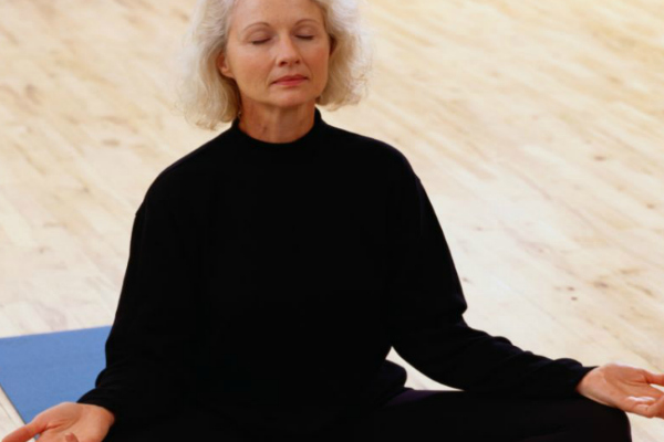 Woman meditating in a seated position